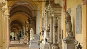 Tourists walking in arcade with beautiful marble statues, tour at Mirogoj park. Stock footage stock video footage