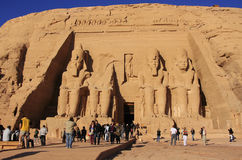 Tourists walking around the Great temple of Abu Simbel, Nubia Royalty Free Stock Photo