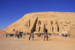 Tourists walking around the Great temple of Abu Simbel, Nubia Royalty Free Stock Images