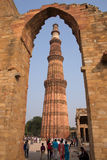 Tourists walking around Qutub Minar complex in Delhi, India Stock Images