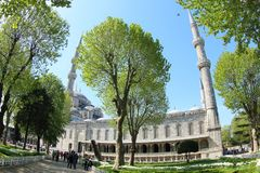 Tourists at Sultan Ahmet Mosque, Istanbul. Tourists walking around Sultan Ahmet Mosque, also known as Blue Mosque, Istabul, Turkey. A popular tourist site, the Royalty Free Stock Images