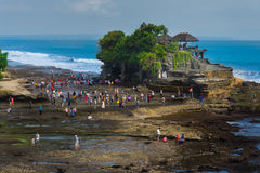 Tourists walking around Tanah Lot temple Stock Photography