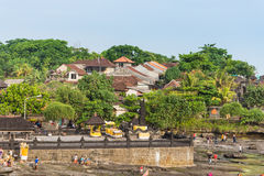 Tourists walking around Tanah Lot temple Royalty Free Stock Images