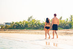 Tourists Walking On The Beach Stock Photos
