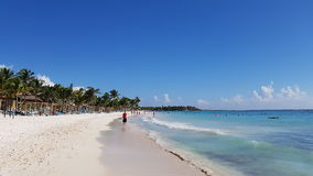 Tourists walking on the beach in Mexico, Riviera Maya. Tourists walking on the beach in Mexico, akumal, Maya stock photo