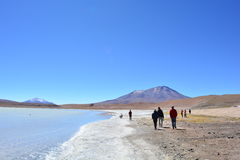 Tourists walking at a beautiful salt lake in Bolivia Stock Images