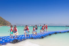 Tourists walking on blue pontoon to the beach at Coral Island  P Royalty Free Stock Photos