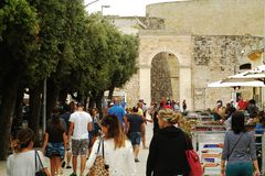 Tourists walking in the center of Otranto - italia. Tourists walking in the center of Otranto, in a cloudy day Royalty Free Stock Image