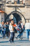 Tourists walking on Charle Bridge during beautiful autumn day, Prague, Czech Republic royalty free stock images