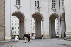 Tourists walking by city Salzburg in autumn. Stock Photography
