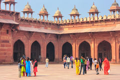 Tourists walking in the courtyard of Jama Masjid in Fatehpur Sik Royalty Free Stock Photo