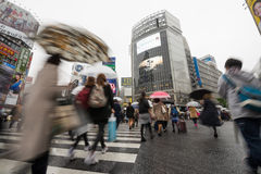 Tourists walking cross the road at famous Shibuya Crossing Royalty Free Stock Photography