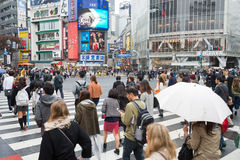 Tourists walking cross the road at famous Shibuya Crossing Royalty Free Stock Images