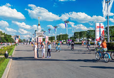 Tourists walking and cycling in the Exhibition of Economic Achie Stock Photo