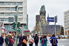 Tourists walking in direction of Kaiser Wilhelm memorial church in Berlin Stock Image
