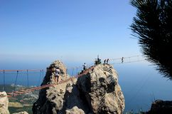Tourists walking down Ay Petry`s extreme bridge. Stock photo of tourists walking down Ay Petry`s extreme bridge royalty free stock photography