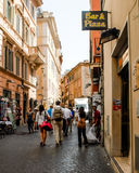 Tourists walking down a street in Rome, Italy. Stock Photo