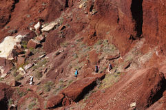Tourists walking down to Red Beach,Santorini,Greece. Royalty Free Stock Photography
