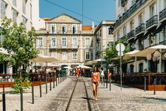 Tourists Walking Downtown Lisbon City In Portugal Royalty Free Stock Photo