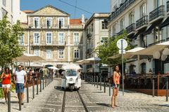 Tourists Walking Downtown Lisbon City In Portugal Royalty Free Stock Images