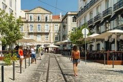 Tourists Walking Downtown Lisbon City In Portugal Stock Photo