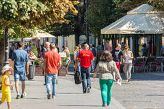 Tourists Walking Downtown Royalty Free Stock Image