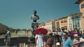 Tourists walking on famous Firenze landmark Ponte Vecchio bridge. Florence, Italy - August 1, 2019: Tourists walking on famous Firenze landmark Ponte Vecchio stock footage