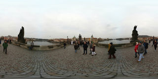 Tourists walking on famous landmark Charles Bridge at day time Stock Photo