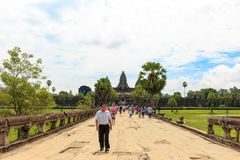 Tourists Walking in Front of Angkor Wat Temple in Cambodia royalty free stock photos