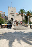 Tourists walking in front of the castle at Korcula Royalty Free Stock Images