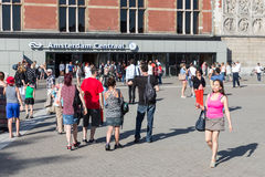 Tourists walking in front of the central station of Amsterdam Royalty Free Stock Photo