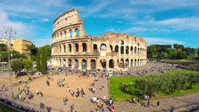 Tourists walking in front of the Colosseum stock video footage