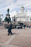 Tourists walking in front of Helsinki cathedral royalty free stock photo