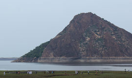 Tourists walking in front of the hill. At thirimoorthy hill,tamilnadu, india Stock Image