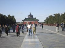 Tourists Walking in Front of the Temple of Heaven in Beijing. Tourists are walking down the pathway in front of the Temple of Heaven in Beijing Royalty Free Stock Images