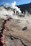 Tourists walking in geysers field. El Tatio. Antofagasta region. Chile Royalty Free Stock Photo