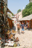 Tourists walking between the gift shops at Mostar Royalty Free Stock Photos