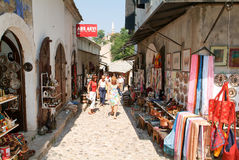 Tourists walking between the gift shops at Mostar Royalty Free Stock Photography