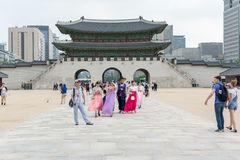 Tourists walking into the Gyeongbokgung Palace royalty free stock images