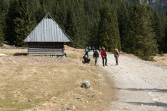 Tourists walking on hiking path in Chocholowska valle Stock Image