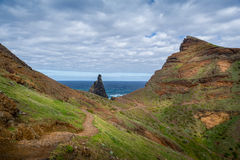 Tourists walking at hiking path on the east coast of Madeira island. Stock Image