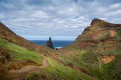 Tourists walking at hiking path on the east coast of Madeira island. Stock Image