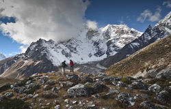 Tourists walking in the Himalayas stock image