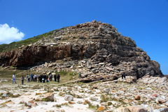 Tourists walking at Hope Cape. Stock Photo
