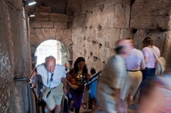 Tourists walking inside colosseum stairs at Rome Royalty Free Stock Image