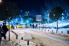 Tourists walking on Istanbul streets after snow storm royalty free stock photography