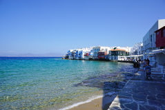 Tourists walking at Little Venice in Mykonos, Greece. Royalty Free Stock Photography