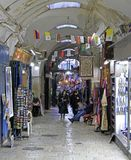 Tourists are walking by market in the old city Royalty Free Stock Photography