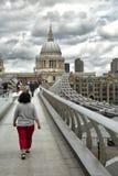 Tourists walking on milenium bridge in London Stock Photography