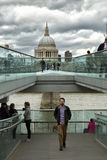 Tourists walking on milenium bridge in London Stock Photo